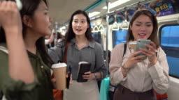 Girlfriends Having Fun On A Subway Train