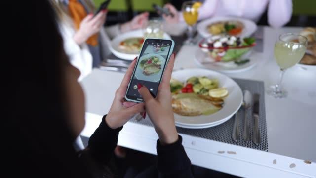 girlfriends having fun on lunch break - foodie stock videos & royalty-free footage