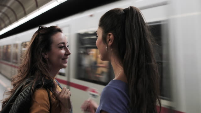 girlfriends on subway platform waiting for train - girlfriend stock videos & royalty-free footage