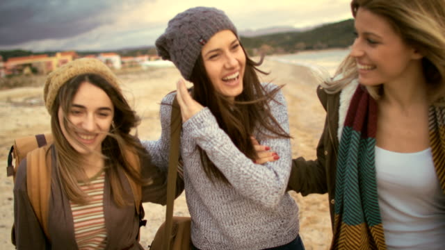 girlfriends on the beach 4k - three people stock videos & royalty-free footage