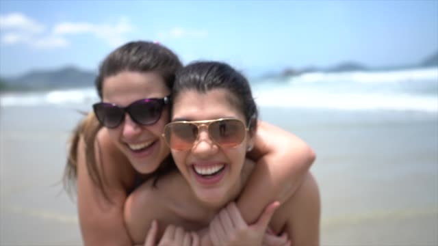 girlfriends portrait at beach - tourism stock videos & royalty-free footage