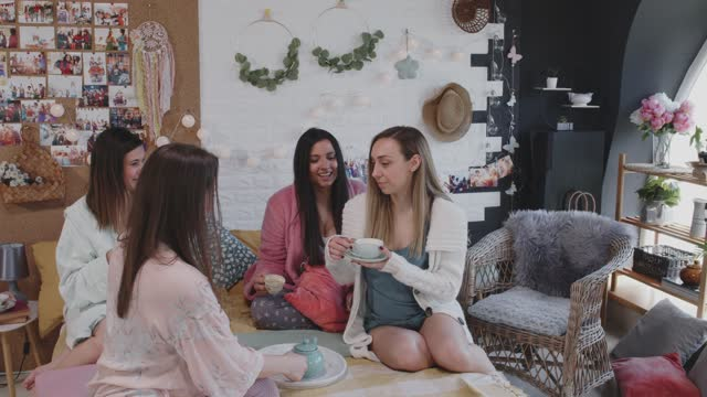 girlfriends sitting on bed and drinking tea, morning after a sleepover - nightwear stock videos & royalty-free footage