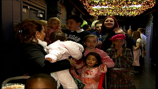 Girls Aloud at Harrods Christmas Parade Children queuing outside Santa's Grotto in Harrods DISSOLVE TO Boy meeting Santa Claus and whispering in his...