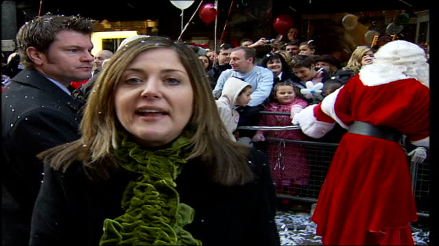 Girls Aloud at Harrods Christmas Parade Reporter to camera