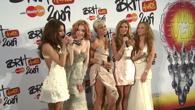 Girls Aloud storm off stage when the compere of the press conference asked them if they were going to split up at the Brit Awards Backstage at London