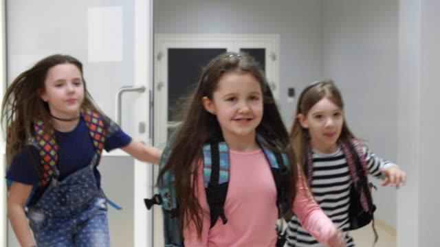 girls and boys leaving classroom - boys stock videos & royalty-free footage