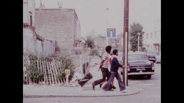 girls and boys walk along quiet street in brixton; 1973 - multiple image stock videos & royalty-free footage
