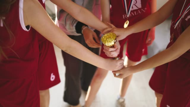 girls and coach celebrating winning a trophy - medallist stock videos & royalty-free footage