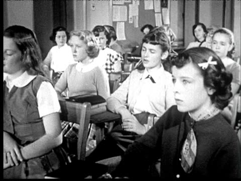 1953 b/w girls at desk in classroom, teacher in front of blackboard drawing of uterus - teenage girls stock videos & royalty-free footage