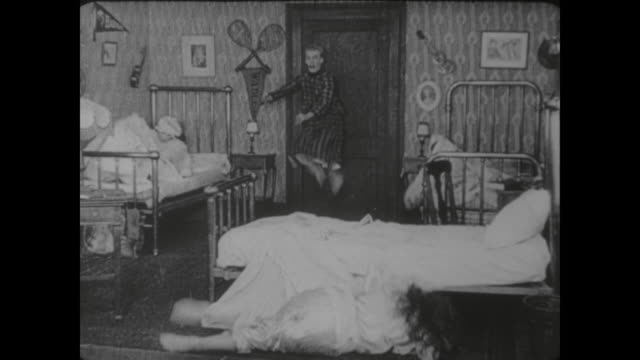 1917 girls attack man (al st. john) who enters their dorm room to hide from dog - pillow fight stock videos & royalty-free footage