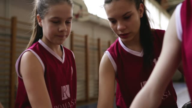 girls basketball players holding hands together on court - pre adolescent child stock videos & royalty-free footage