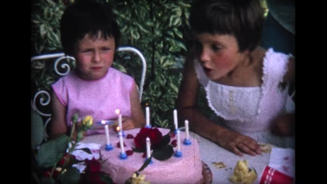 1964 girl's birthday cake at swiss garden party - home movie video stock e b–roll