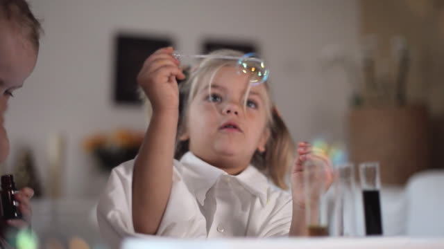 cu girls (12-23 months, 4-5 years) blowing bubbles / potsdam, brandenburg, germany - 4 5 years stock videos and b-roll footage