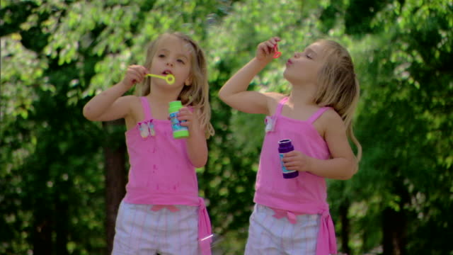 girls blowing bubbles - see other clips from this shoot 1428 stock videos & royalty-free footage