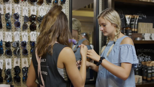 girls browsing for sunglasses in retail store / provo, utah, united states - provo stock videos & royalty-free footage