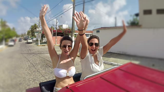 girls buggy drive along the beach - dune buggy stock videos and b-roll footage
