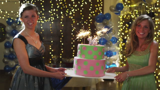 slo mo ms ds girls (12-15) carrying birthday cake at a sweet 16 party / cedar hills, utah, usa - birthday stock videos & royalty-free footage