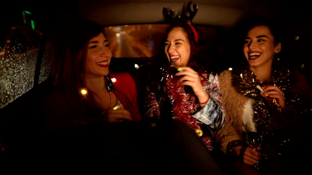 girls celebrating in taxi, on their way to the party - dancing back to back stock videos & royalty-free footage