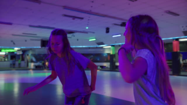 stockvideo's en b-roll-footage met girls dancing and singing in circle at roller skating rink / orem, utah, united states - driekwartlengte