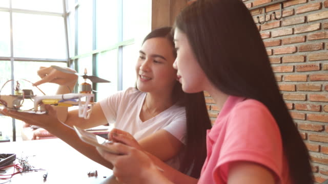 Girls developing an DIY electronic Drone