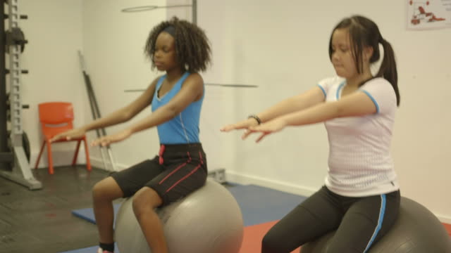 Girls doing exercise in gym