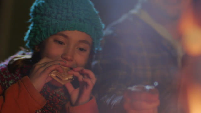 ms. girls eat s'mores and roast marshmallows with dad by campfire. - coat garment stock videos & royalty-free footage