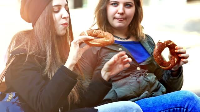 hd: girls eating bagels - bagel stock videos & royalty-free footage