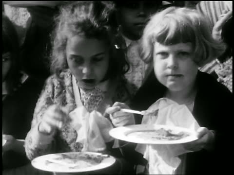 b/w 1929 2 girls eating slices of world's largest pie outdoors / albion, ny / newsreel - 1920 1929 stock videos & royalty-free footage