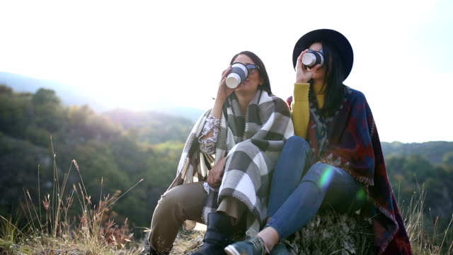 girls enjoy on sun and drink coffee - coffee drink stock videos & royalty-free footage