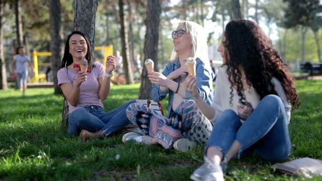 girls enjoying ice cream in the park - three people stock videos & royalty-free footage