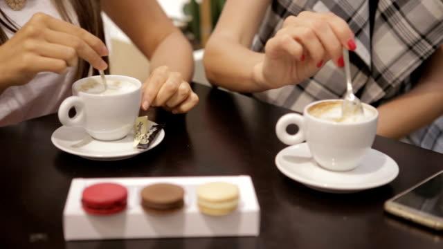 girls enjoying in a coffee shop - macaroon stock videos & royalty-free footage