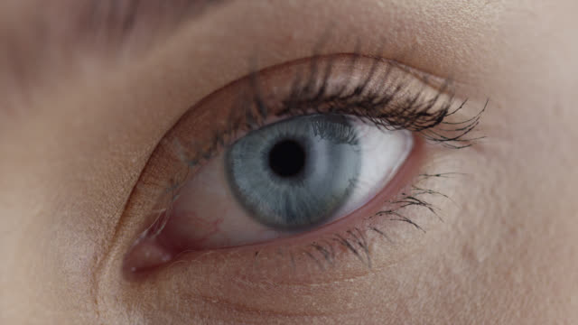 girl's eye. fashion video. make-up. - blue eyes stock videos & royalty-free footage