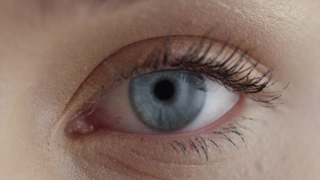 girl's eye. fashion video. make-up. - eyeball stock videos & royalty-free footage