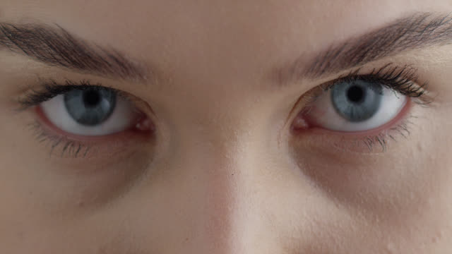 girl's eyes. fashion video. make-up. - blue eyes stock videos & royalty-free footage
