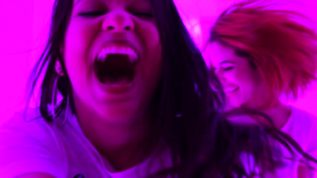 girls following someone toward colorful tunnel - celebration concept - following moving activity stock videos and b-roll footage