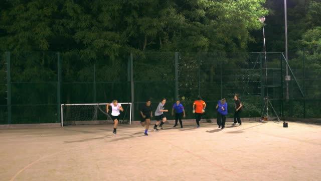 A girls football team sprint during training