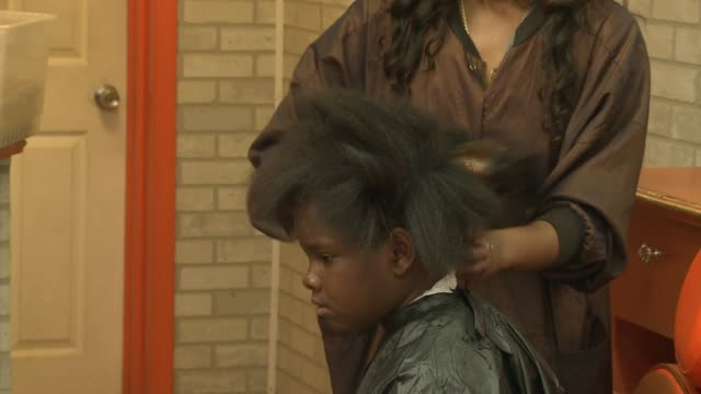 wgn girls getting their hair done on august 24 2013 in chicago illinois - barber shop stock videos and b-roll footage