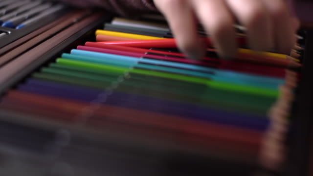 cu girl's hand picking up coloured pencils - choice stock videos & royalty-free footage