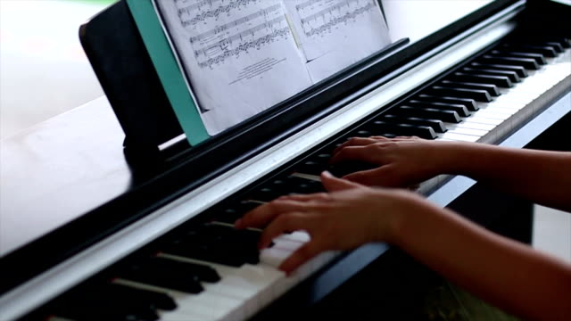 Girl's hands on piano