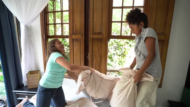 girls having a pillow fight - pillow stock videos & royalty-free footage