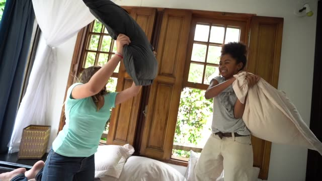 girls having a pillow fight - pillow fight stock videos & royalty-free footage
