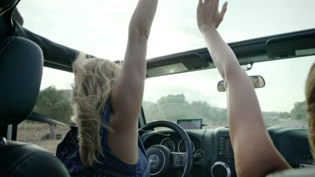 girls having fun in a suv. hands on sun roof. - 4x4 stock videos & royalty-free footage