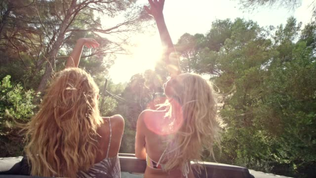 girls having fun in a suv with sun roof - long hair stock videos & royalty-free footage