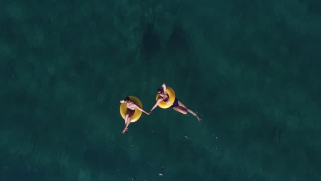 Girls having fun in the ocean 4K