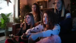 Girls having fun playing video games