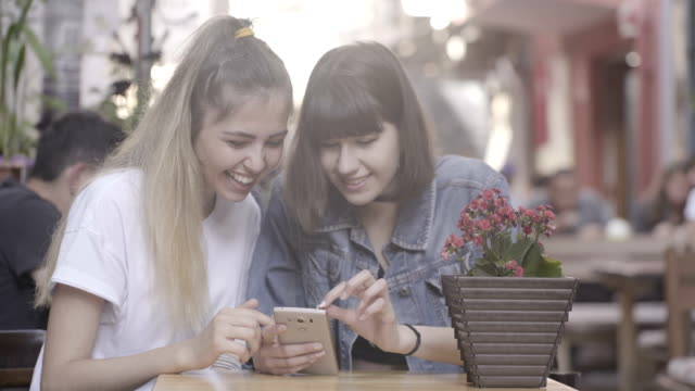 Girls having fun with smartphone app