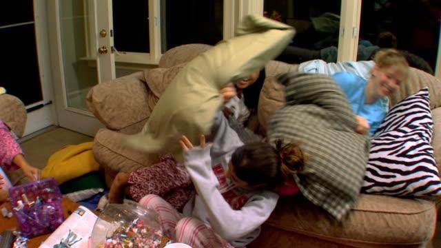 Girls having pillow fight