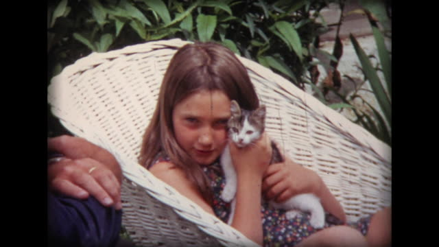 1971 girls holding kitten - home movie stock videos & royalty-free footage