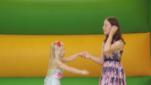 girls in bouncy castle - 30 seconds or greater stock videos & royalty-free footage