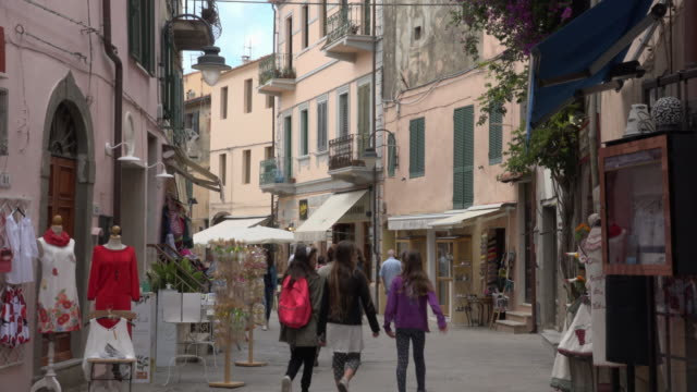 girls in old town alley - island of elba stock videos & royalty-free footage